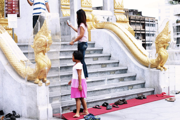 Take shoes off before entering Temple